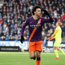 Leroy Sane celebrates scoring Manchester City's third goal at Huddersfield (Martin Rickett/PA)