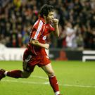 Former midfielder Luis Garcia believes the pressure is all on Liverpool's title rivals (Peter Byrne/PA).