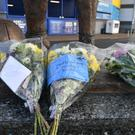Flowers have been left near Cardiff's stadium after after a plane with new signing Emiliano Sala on board went missing over the English Channel. (Ben Birchall/PA Images)