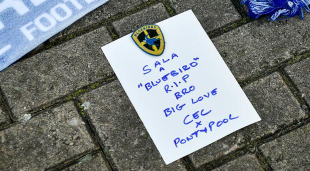 A tribute is left to Emiliano Sala outside Cardiff's stadium (Ben Birchall/PA)