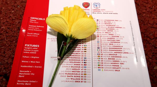 The match day programme for Arsenal v Cardiff featuring the squad lists on the back and the name of Emiliano Sala alongside a Daffodil before the Premier League match at the Emirates Stadium, London.