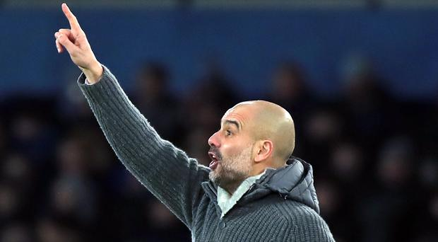 Manchester City manager Pep Guardiola challenged Liverpool to respond after his side went top of the Premier League (Peter Byrne/PA)