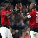 Ashley Young, right, has praised Paul Pogba's performances (Nigel French/PA)