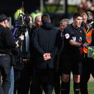 Mauricio Pochettino, centre, confronts referee Mike Dean following Tottenham's defeat by Burnley (Martin Rickett/PA)