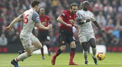 Andrew Robertson, left, felt Liverpool missed an opportunity at Old Trafford (Jon Super/AP)