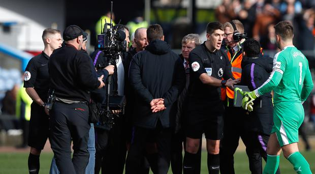 Tottenham manager Mauricio Pochettino (centre) speaks to referee Mike Dean after Saturday's defeat to Burnley (Martin Rickett/PA)