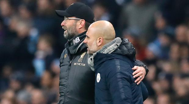 Can Jurgen Klopp, left, and Pep Guardiola take their teams to the quarter-finals? (Martin Rickett/PA)