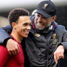 Trent Alexander-Arnold, left, is loving life at Liverpool (Adam Davy/PA)