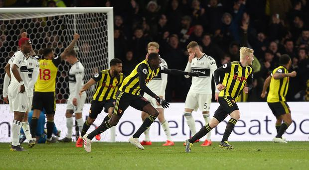 Watford's Will Hughes (right) celebrates scoring his side's second goal of the game with team-mates during the Premier League match at Vicarage Road, Watford.