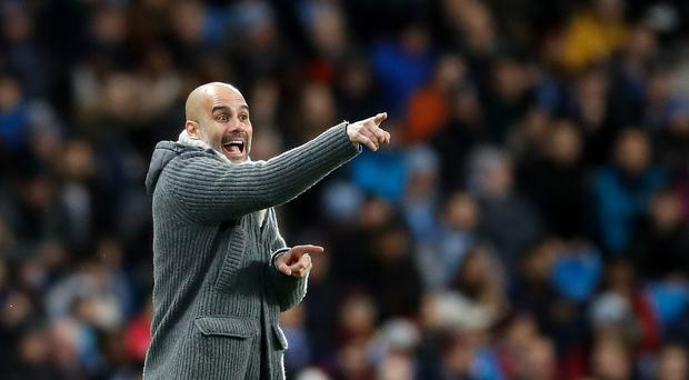Manchester City manager Pep Guardiola is keen to keep his players' feet on the ground (Martin Rickett/PA)