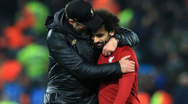 Jurgen Klopp (left) insists neither he nor Mohamed Salah (right) are bothered by the Egypt international's goalscoring drought (Peter Byrne/PA)