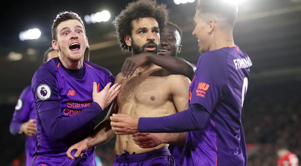 Mohamed Salah, centre, scored a superb solo goal at Southampton (Adam Davy/PA)