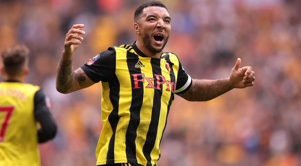 Troy Deeney celebrates scoring his side's second goal in the FA Cup win over Wolves. (John Walton/PA)