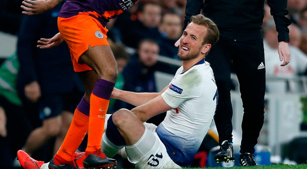 Sore point: Harry Kane is injured in a tackle with Fabian Delph