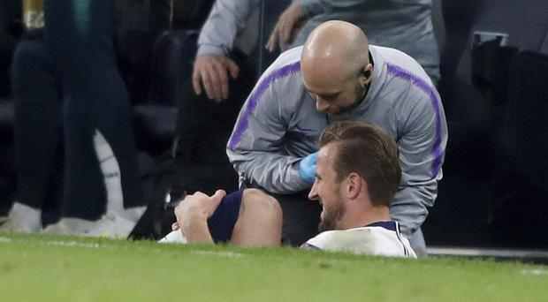 Harry Kane has ankle ligament damage (Frank Augstein/AP)