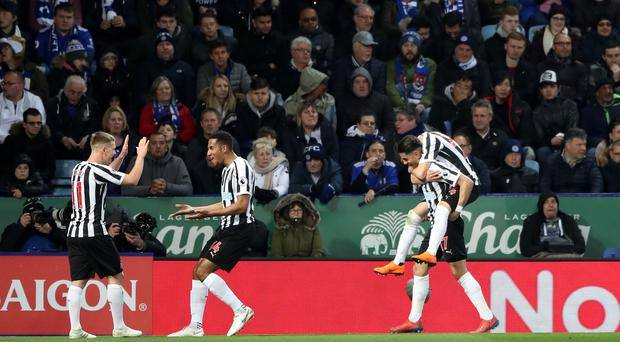 Newcastle's Ayoze Perez (bottom right) celebrates his goal at Leicester. (Nick Potts/PA)
