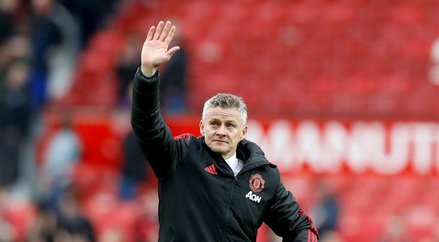 Manchester United's manager Ole Gunnar Solskjaer acknowledges the crowd after the final whistle during the Premier League match at Old Trafford, Manchester.