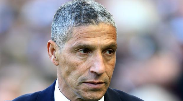 Chris Hughton expects a reaction from Brighton's players (Gareth Fuller/PA)