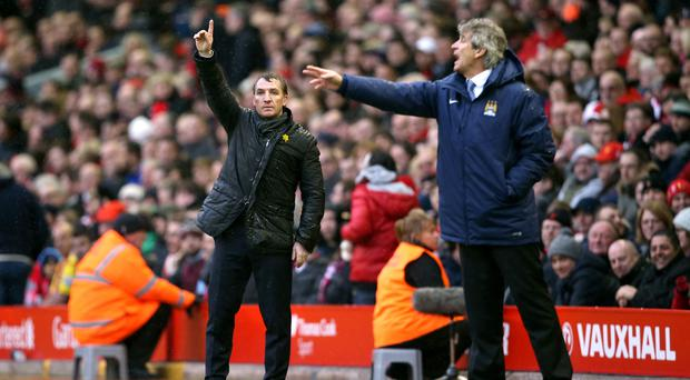 Brendan Rodgers (left) and Manuel Pellegrini (right) were title rivals in their Liverpool and Manchester City days (Lynne Cameron/PA)