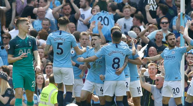 Manchester City's Phil Foden (centre) celebrates his goal against Tottenham (Martin Rickett/PA)