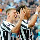 Newcastle's Ayoze Perez (right) is congratulated by team-mate Matt Ritchie as he celebrates his hat-trick (Richard Sellers/PA)
