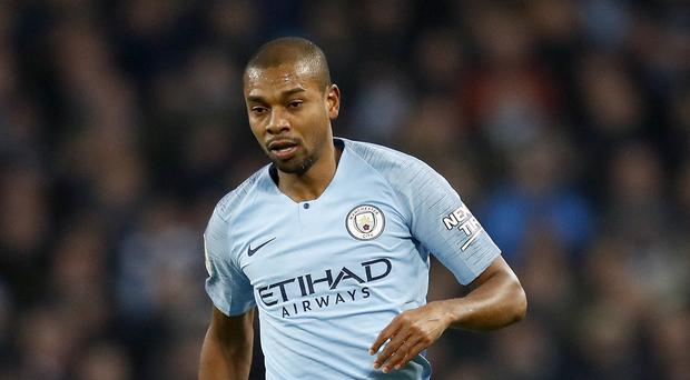 Fernandinho suffered a knee injury in Manchester City's derby victory (Martin Rickett/PA)