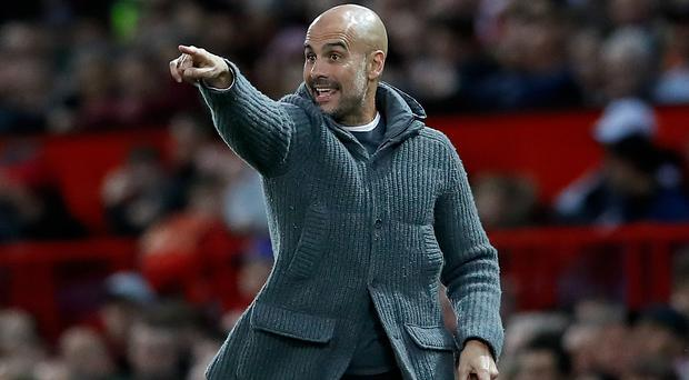 Pep Guardiola believes Manchester City and Liverpool have pushed each other on this season (Martin Rickett/PA)