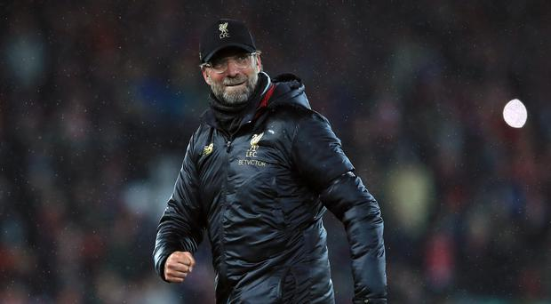 Liverpool manager Jurgen Klopp celebrates after the final whistle during the Premier League match at Anfield, Liverpool.