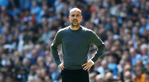 Pep Guardiola says Manchester City must go full throttle in their remaining games (Martin Rickett/PA)