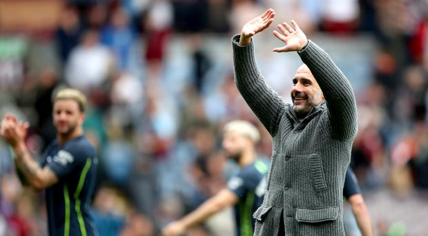 Pep Guardiola could celebrate after a tense afternoon at Turf Moor (Nick Potts/PA)