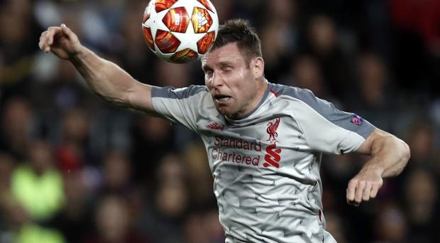 Liverpool's James Milner believes they will bounce back from defeat in Barcelona (Joan Monfort/AP)