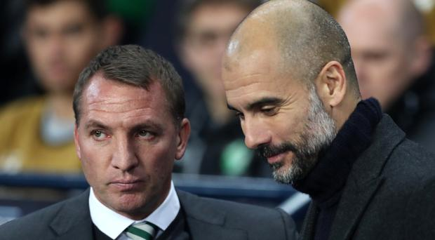 Pep Guardiola (right) has a lot of respect for Brendan Rodgers (left) (Martin Rickett/PA)