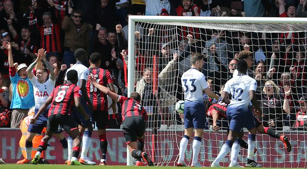Nathan Ake (obscured) scores the winner (Mark Kerton/PA)
