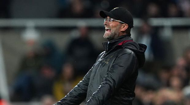 Liverpool manager Jurgen Klopp was thrilled with a gritty Premier League victory at Newcastle (Owen Humphreys/PA)