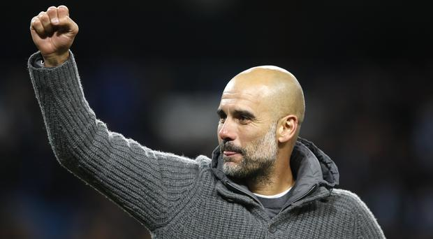 Pep Guardiola is calling for one last effort from Manchester City to secure the Premier League title (Martin Rickett/PA)