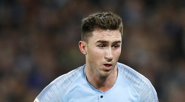 Aymeric Laporte is keen to get his hands on the Premier League trophy (Martin Rickett/PA)