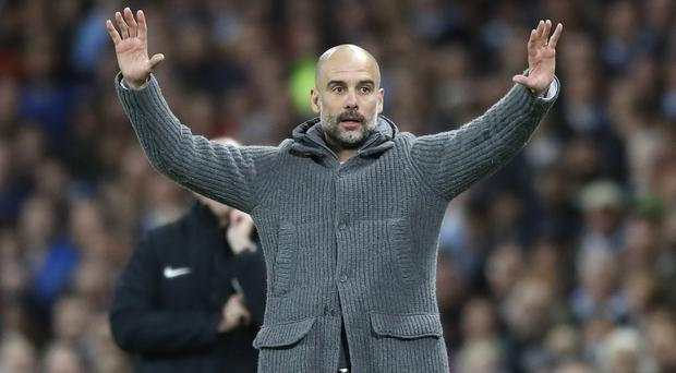 Manchester City manager Pep Guardiola insists he is not feeling the nerves (Martin Rickett/PA)