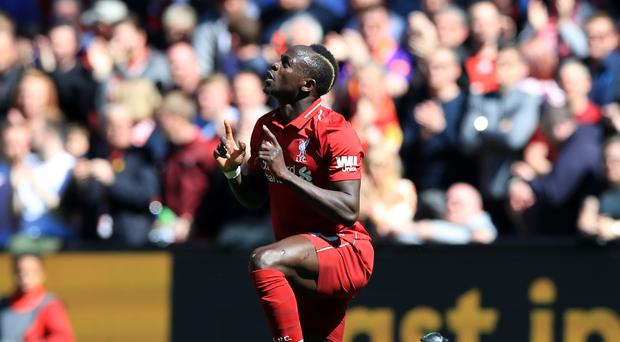 Liverpool's Sadio Mane celebrates scoring his side's first goal of the game during the Premier League match at Anfield, Liverpool.
