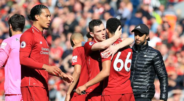 Liverpool players embrace at the end of Sunday's 2-0 win over Wolves (Peter Byrne/PA)