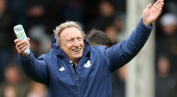 Cardiff manager Neil Warnock is targeting a record ninth promotion after it was agreed that he will remain at the relegated club (Steve Paston/PA)