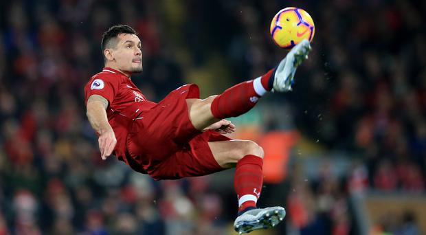 Dejan Lovren insists Liverpool's ongoing improvement will see them challenge for the title again (Peter Byrne/PA)
