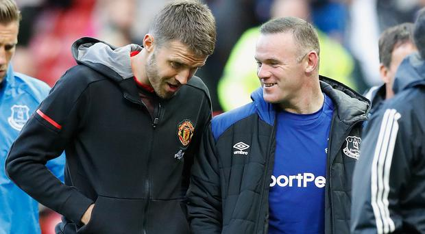 Wayne Rooney, right, has spoken about Ole Gunnar Solskjaer and Michael Carrick, left (Martin Rickett/PA)