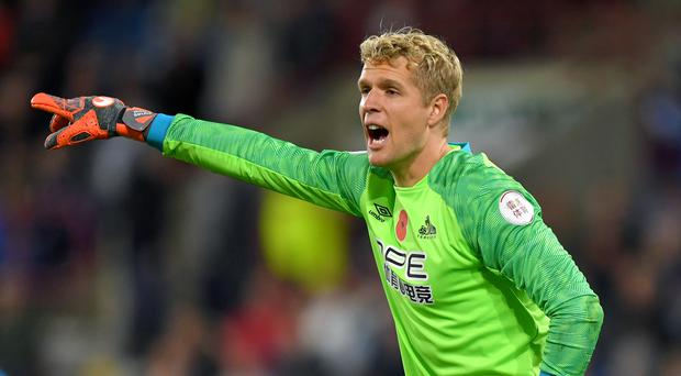 Huddersfield goalkeeper Jonas Lossl is to join Everton on a three-year deal (Dave Howarth/PA)