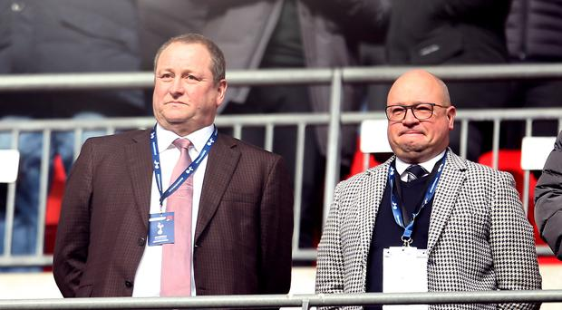 Newcastle owner Mike Ashley (left) is in talks with representatives of Sheikh Khaled bin Zayed Al Nehayan over a sale (Steven Paston/PA)