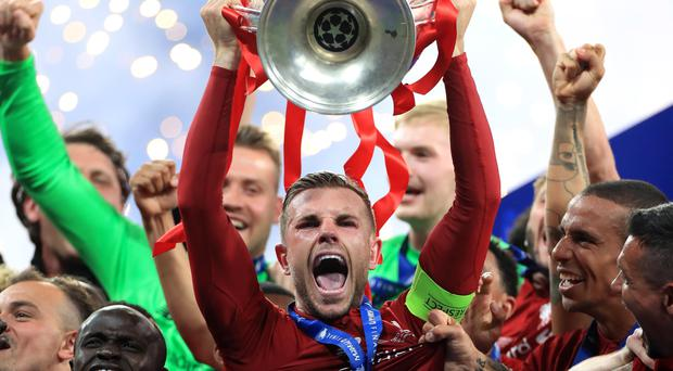 Jordan Henderson lifts the Champions League trophy (Mike Egerton/PA)