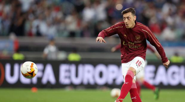 Mesut Ozil could be sold this summer (Bradley Collyer/PA)