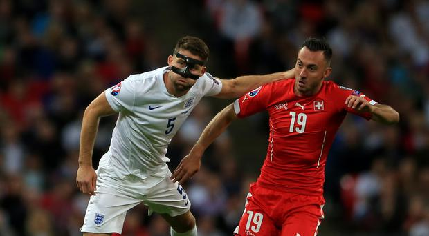 Switzerland striker Josip Drmic, right, will play for Norwich next season (Nick Potts/PA)