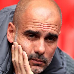 Manchester City manager Pep Guardiola warned about player burnout (Mike Egerton/PA).