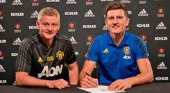 Signing on: Harry Maguire signs a six year contract with Man United alongside boss Ole Gunnar Solskjaer
