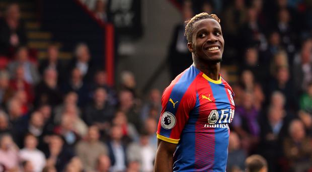 Wilfried Zaha is still keen on leaving Crystal Palace (Isabel Infantes/PA)